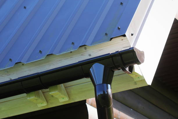 Rain Gutter Pipeline System Installation. Roofing Construction. Rain gutter system and roof protection from snow . Home Guttering, Gutters, Guttering , Drainage Pipe Exterior stock photo