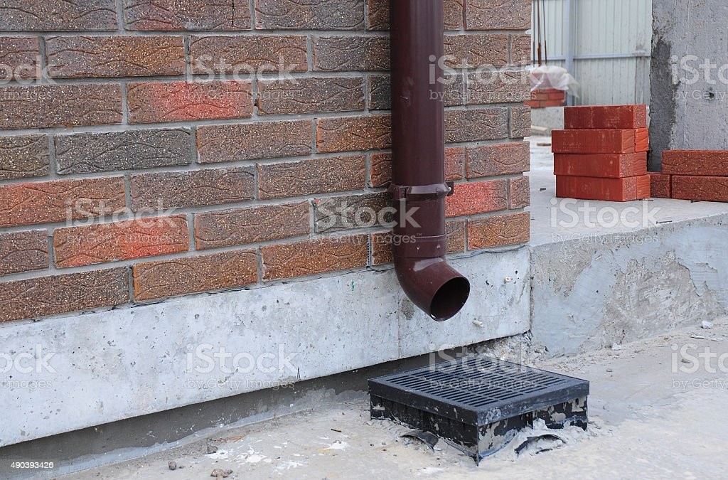 Rain gutter system is designed to catch and remove water stock photo