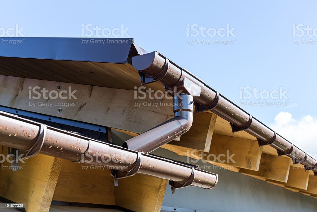 Rain gutter with drainpipe stock photo