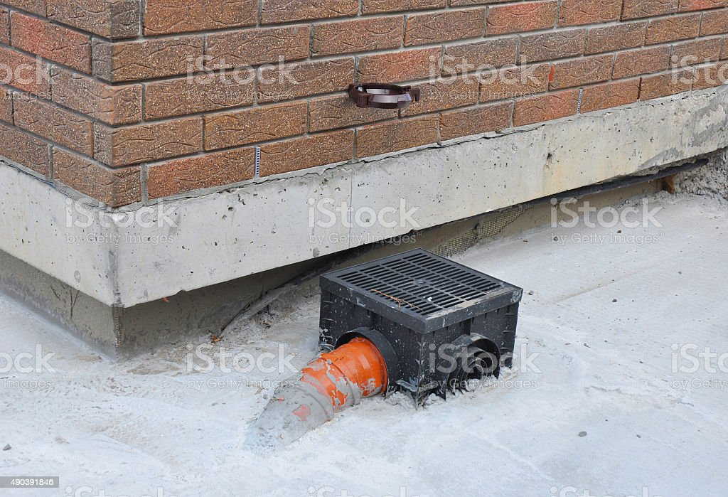 Rain gutter with new installed underground drainage system. stock photo