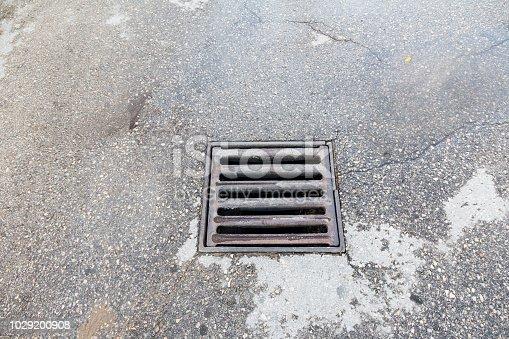 rectangular rain hatch on asphalt