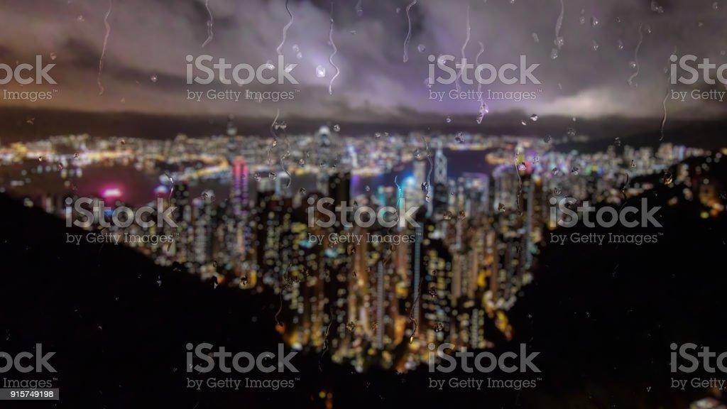 Rain in Hong Kong through a glass window effect stock photo