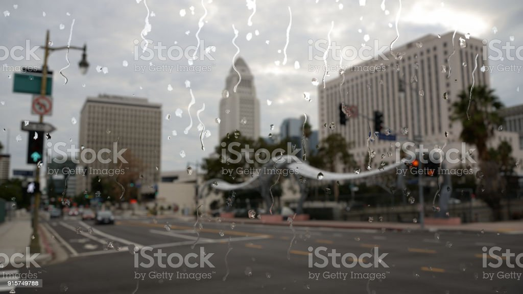 Rain in Los Angeles city center through a glass window stock photo