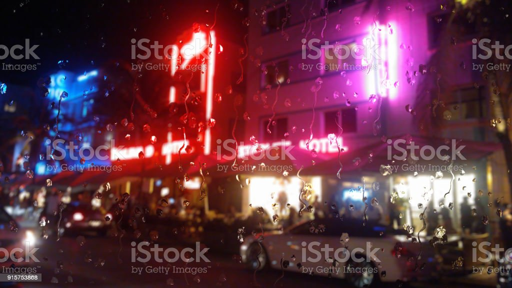 Rain in Miami neon through a glass window effect stock photo