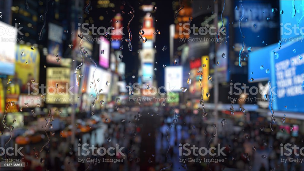 Rain in New York Times Square through a glass window effect stock photo