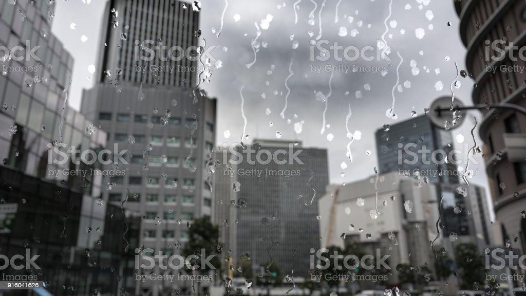 Rain in Osaka, Japan through a glass window effect stock photo