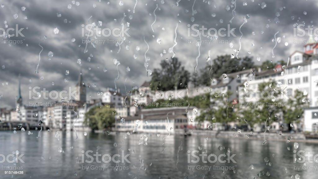 Rain in Zurich, Switzerland through a glass window effect stock photo