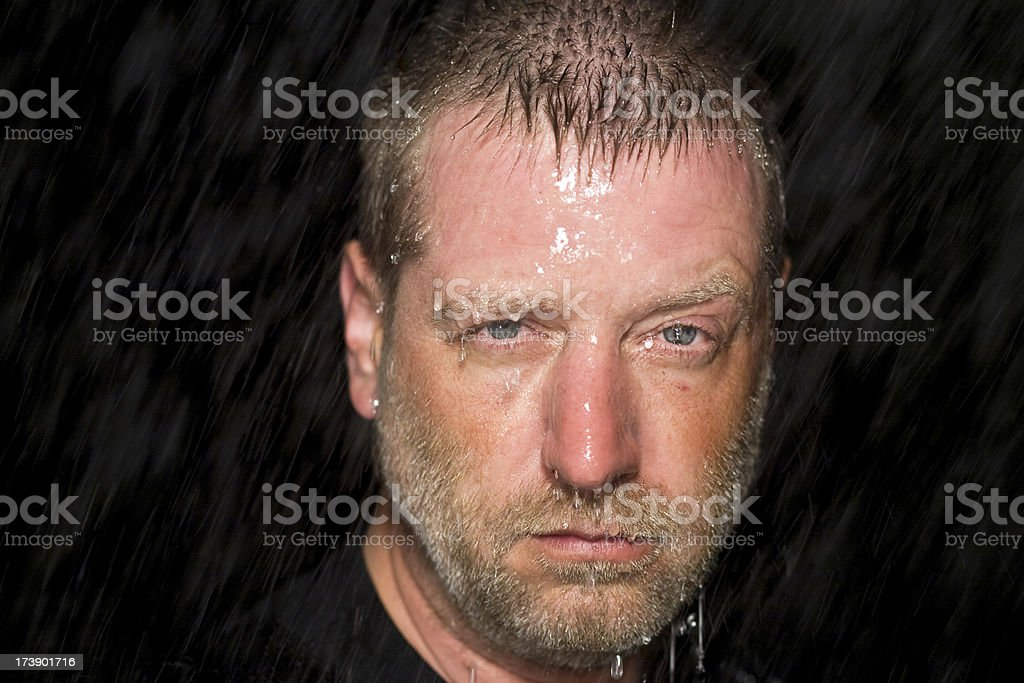 man standing soaked in the rain