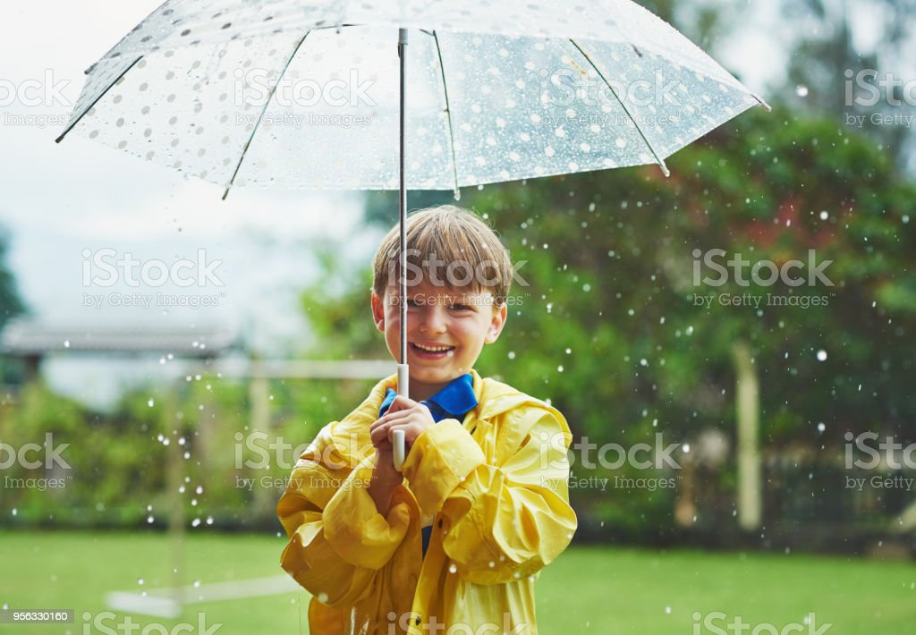 Rain never stops him from going outside stock photo