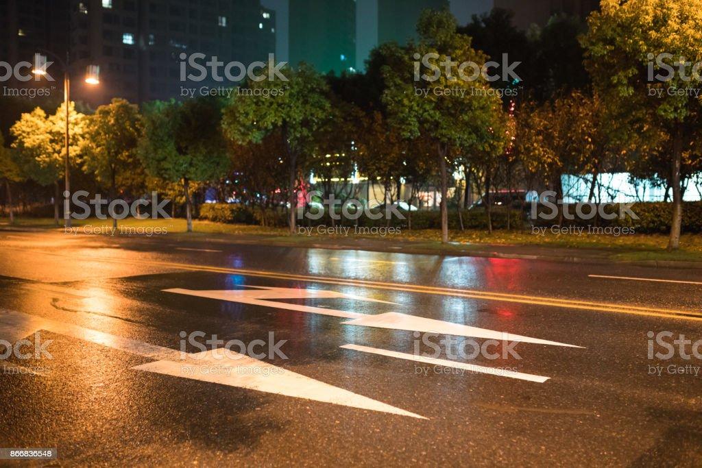 rain night in the street with asphalt road stock photo