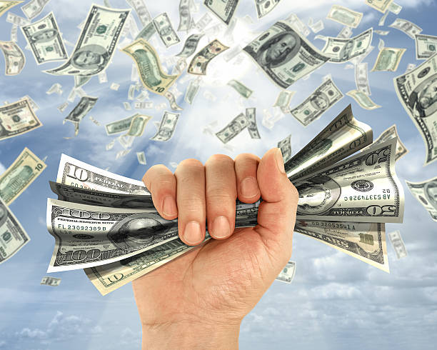 Rain of dollars  handful stock pictures, royalty-free photos & images