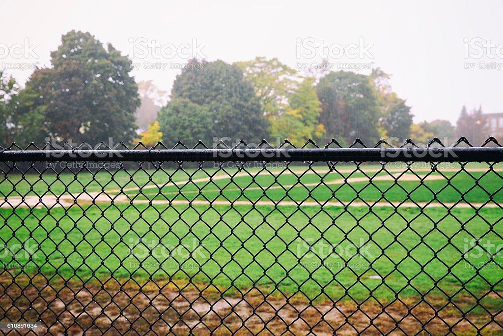 rain on an empty sports field stock photo
