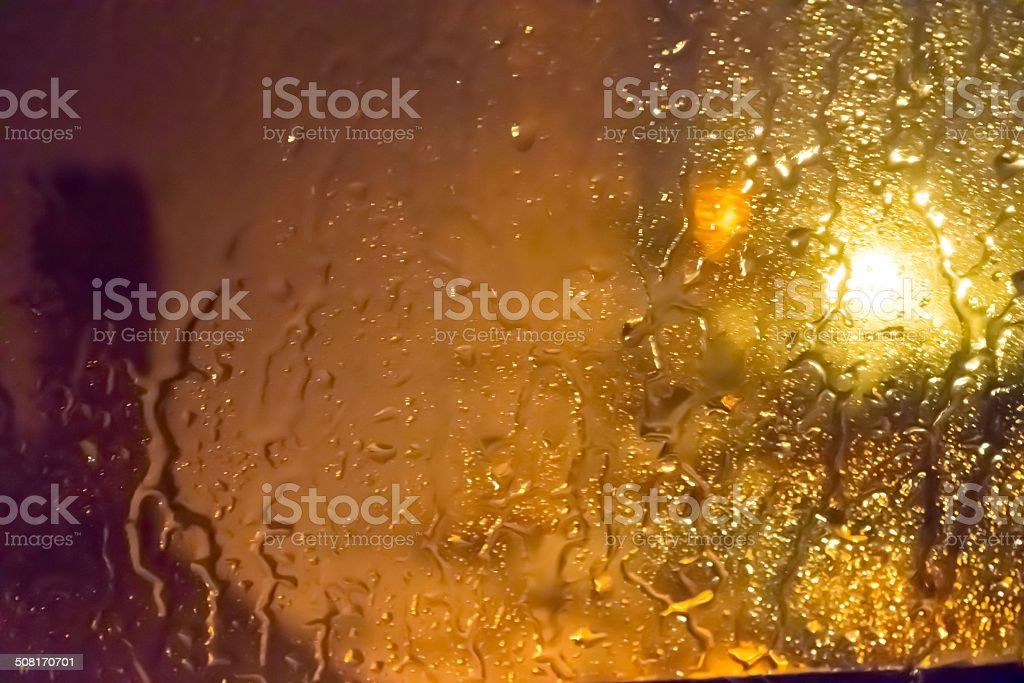Rain on Glass at Night stock photo
