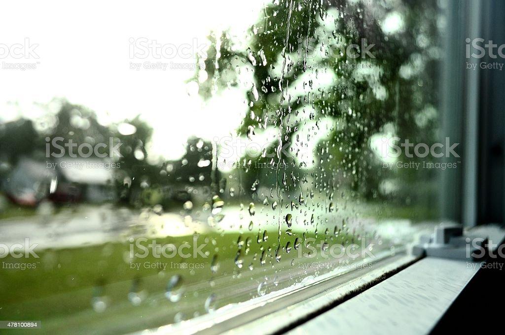 Rain on glass window stock photo