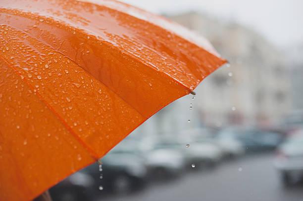 rain on umbrella - umbrellas stock photos and pictures