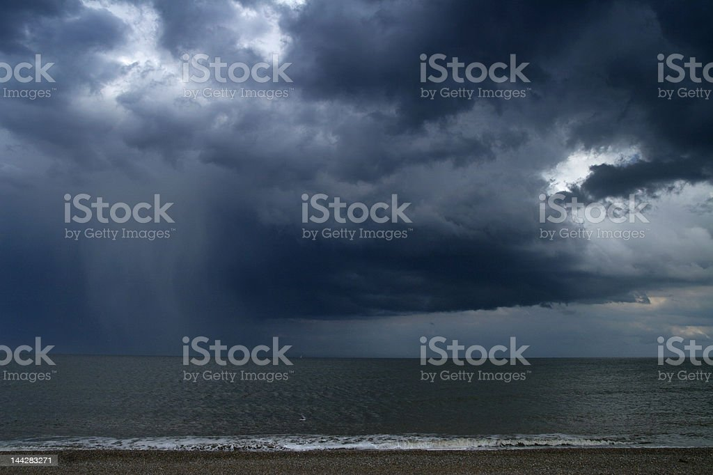 rain over sea stock photo