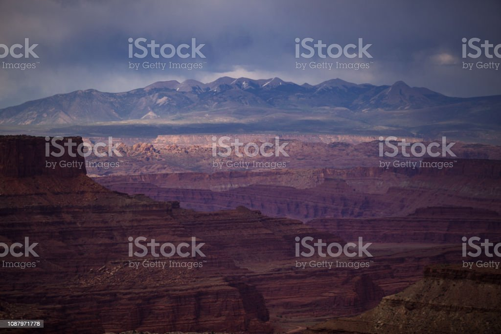 Rain Over the La Sal Mountains from Island in the Sky, Canyonlands National Park stock photo
