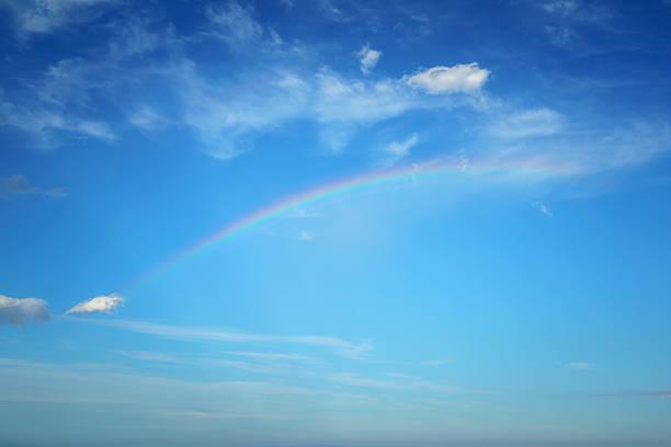 Rain Rainbow in Blue Sky stock photo