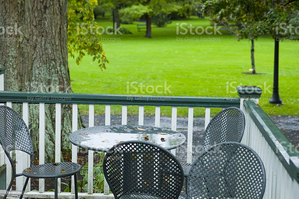Rain Soaked Bistro or Cafe Scene in a Public Garden. royalty-free stock photo