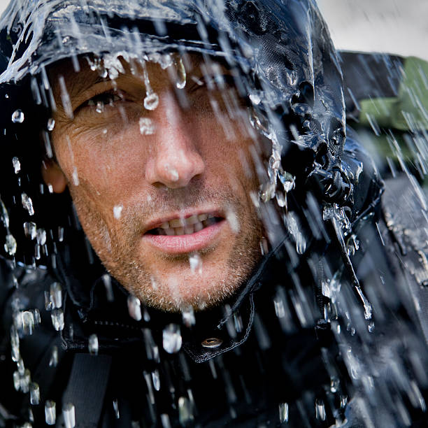 Rain Soaked Hiking Adventurer  waterproof clothing stock pictures, royalty-free photos & images