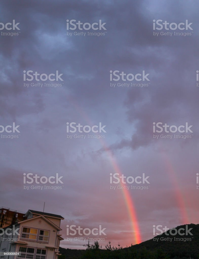 Rain stops and two rainbows stock photo
