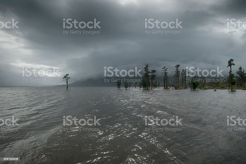 Rain storm over Lake Brunner, New Zealand stock photo