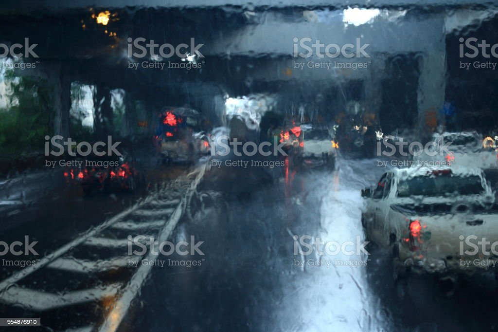 rain strom weather on windshield. visual obstruction poor visibility traffic on fee toll  highway. stock photo