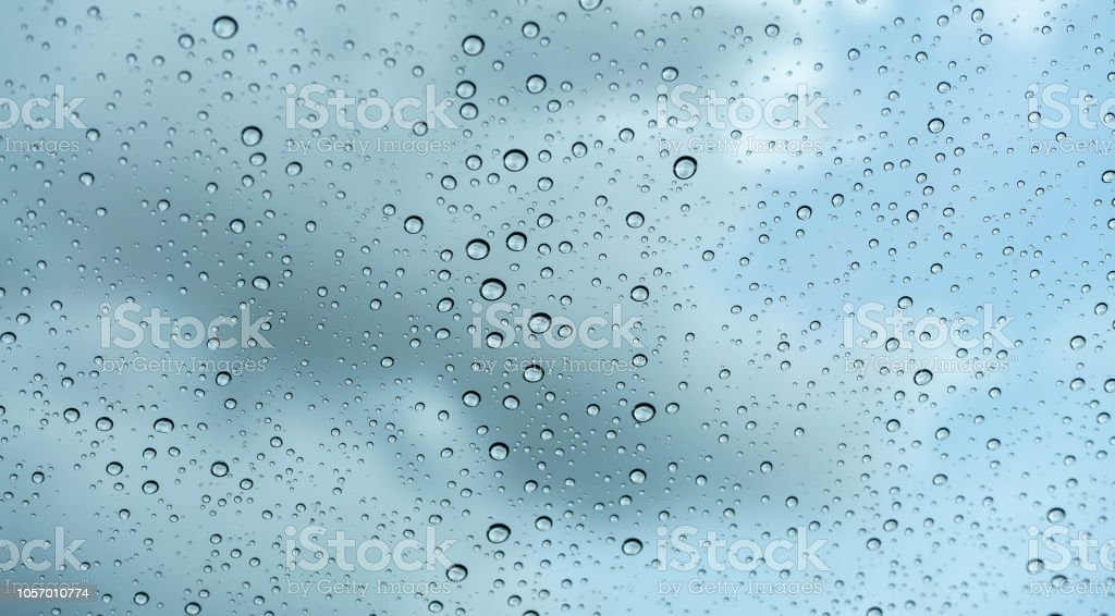 Rain water drop on glass background stock photo