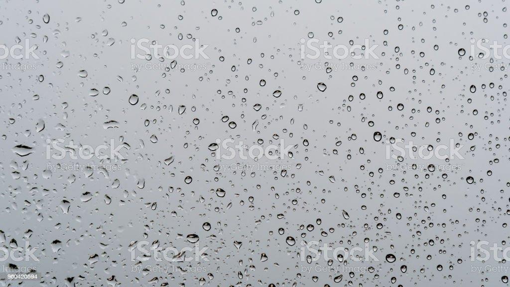 Rain water drop on glass mirror window  Background. Rainy season stock photo