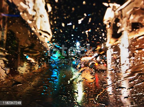 17 October 2019.  Penang, Malaysia. Don't you just love nature's creativity? Rain fall on your car's windscreen sure is art by itself.  The rolling down of raindrops from top of windscreen is entertaining to watch -  if you have nothing to do,  that is. Like me, on this night when I was trapped in my car,  can't get out because of the heavy rainfall. The intensity of rain created a different design all the time on my windscreen. It created a blurred vision of what's outside.  The heritage buildings appeared askew from inside the car.  Lovely images,  like watching the clouds in the sky  form shapes of different animals -  except that this is really fast,  and the 'pattering'  of rain on my car,  well,  noisy.