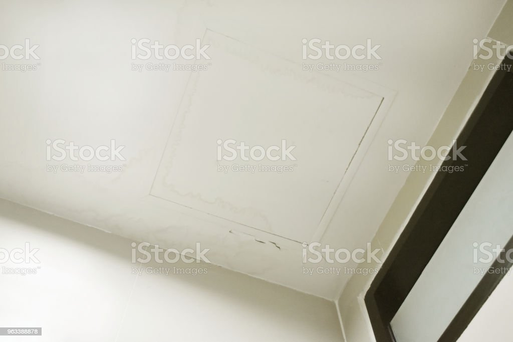 Rain water leaks on the ceiling causing damage, tiles and gypsum board. - Zbiór zdjęć royalty-free (Cement)