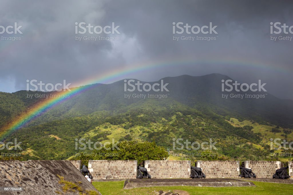 Rainbow above a cannons at Brimstone Hill Fortress on Saint Kitts. West Indies stock photo