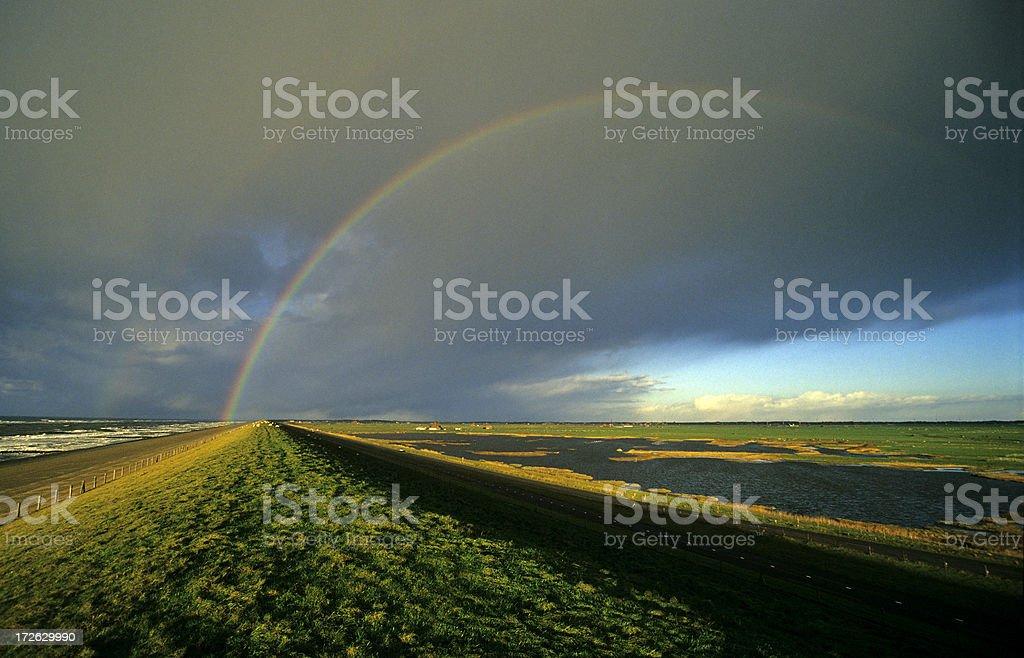 Rainbow above a Dyke royalty-free stock photo