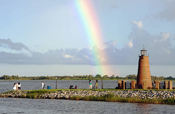 rainbow after a rain at the lakefront - kissimmee stock photos and pictures