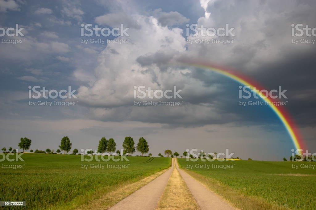 rainbow after a spring storm royalty-free stock photo