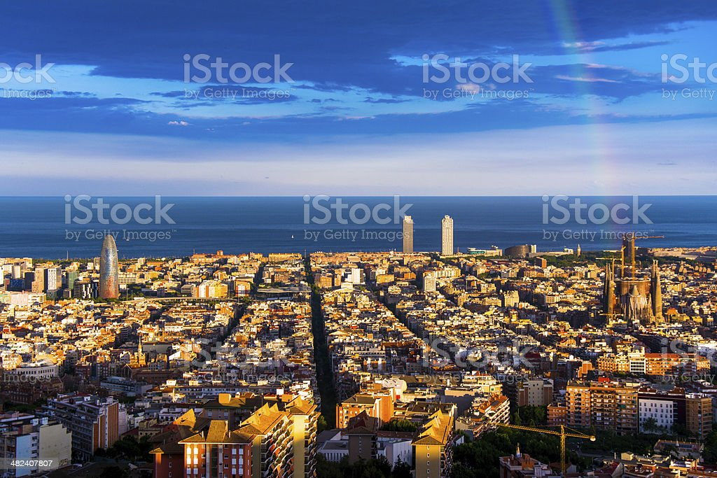 rainbow and barcelona skyline stock photo