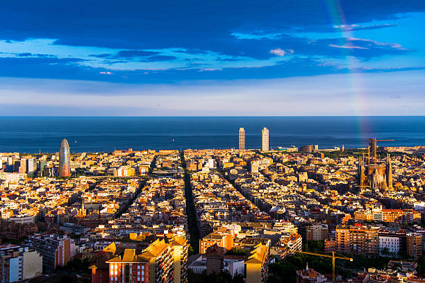 rainbow and barcelona skyline Barcelona city view from the sky with a rainbow crowning the beautiful city. passeig de gracia stock pictures, royalty-free photos & images