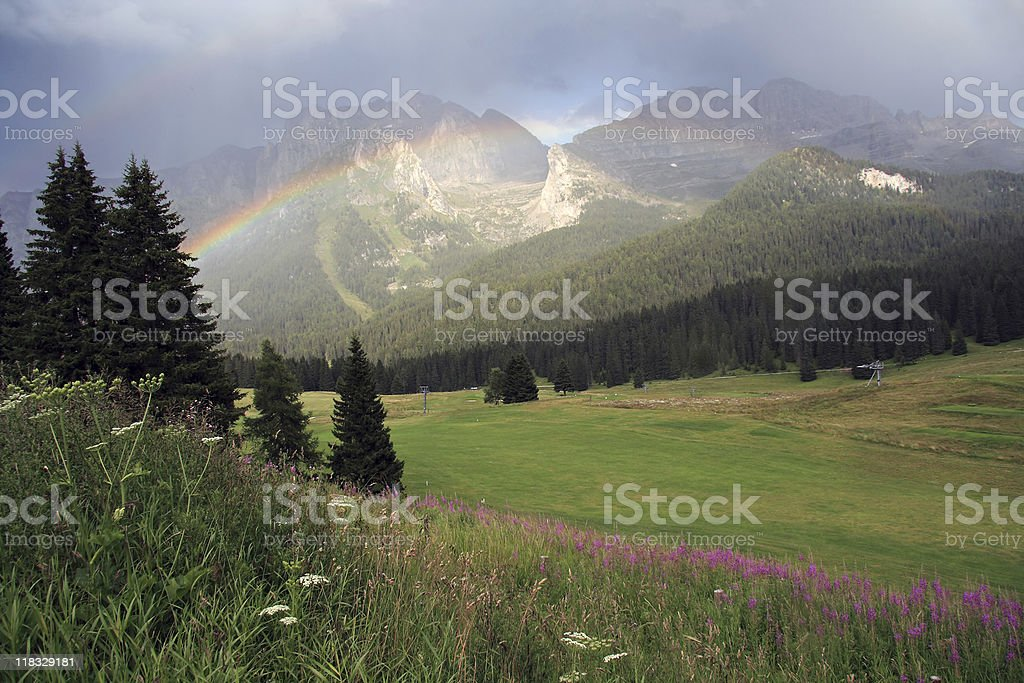 Rainbow and mountains stock photo
