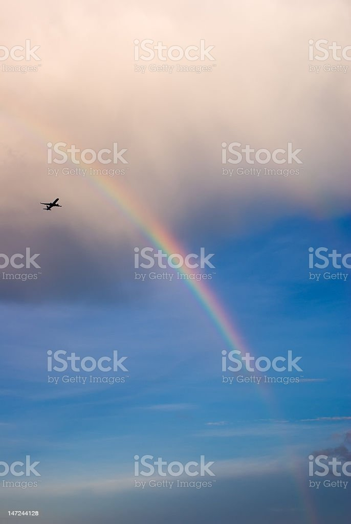 Rainbow and Plane royalty-free stock photo