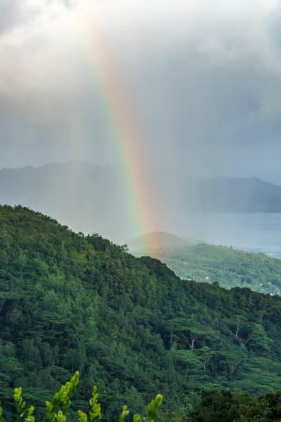 Rainbow And Rain Over The Jungle Mountains Of Mahe Seychelles 7 Stock Photo