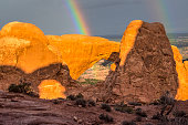 Late afternoon shadows of natural rock arches on a stormy afternoon in Arches National Park, Utah.