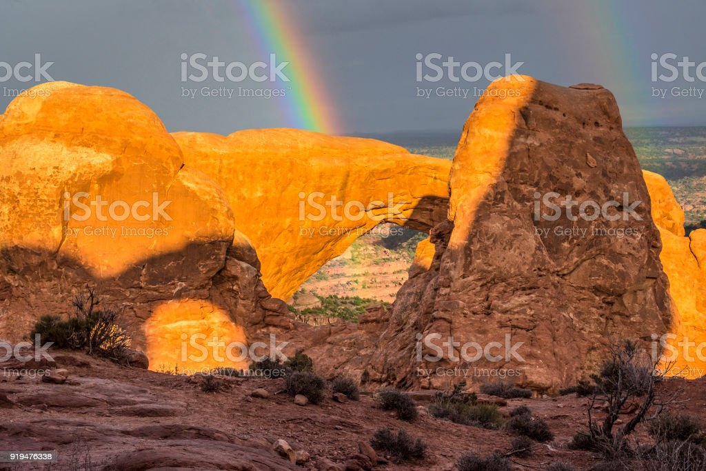 Rainbow and red rock shadows stock photo