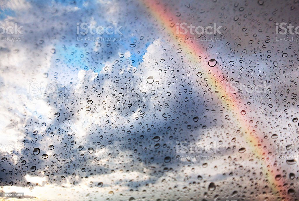 Rainbow and water drops on glass texture stock photo