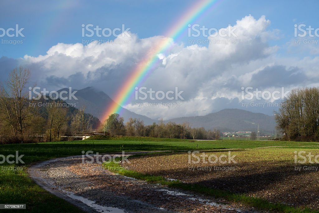Rainbow arch after the rain stock photo