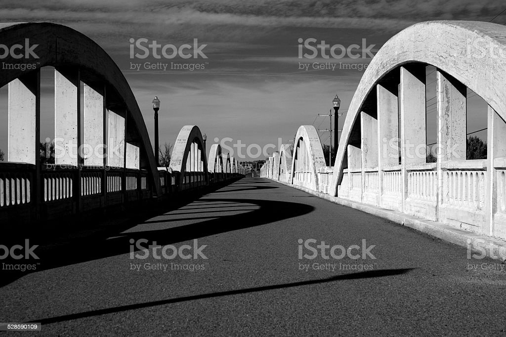 Rainbow Arch Bridge over South Platte River Black and White stock photo
