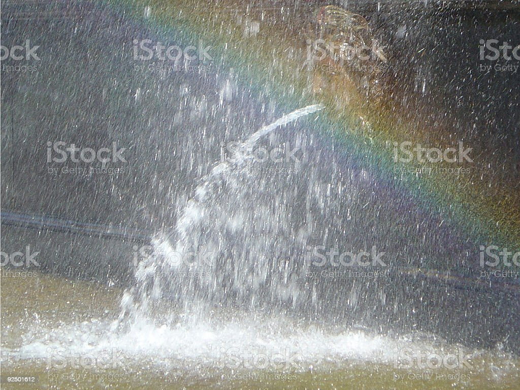 Rainbow Arches Over A Water Fountain royalty-free stock photo