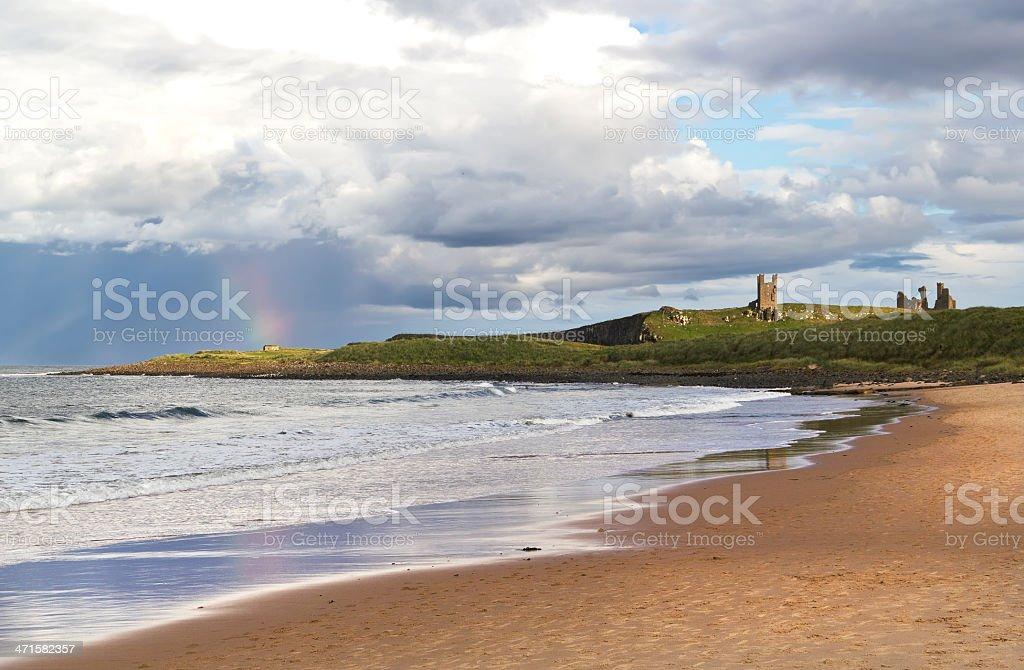 Rainbow at Dunstanburgh Castle stock photo