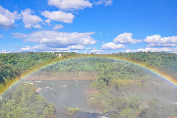 Rainbow at Iguazu Falls, on the border of Brazil, Argentina, and Paraguay. stock photo
