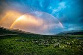 Rainbow on carcass as sun sets