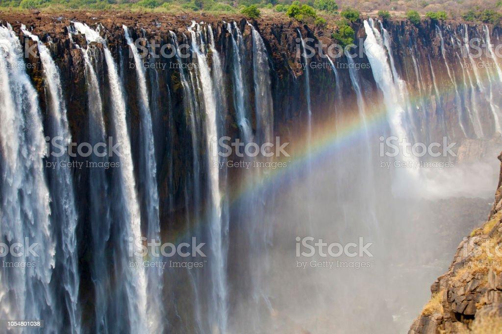 Rainbow at Victoria Falls stock photo